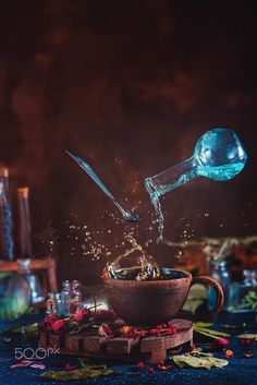 Buy Flying potion bottle with pouring liquid in a magical still life. by dinabelenko on PhotoDune. Flying potion bottle with pouring liquid in a magical still life. Wooden background with magic. Magical Photography, Still Life Photography, Creative Photography, Potion Bottle, Witch Aesthetic, Tea Art, Food Art, Brewing, Fantasy Art