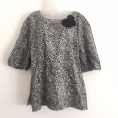 """Lilly Pulitzer Sz XL Black White Rose Blouse NWOT Lilly Pulitzer Sz XL Black White Rose Blouse NWOT.  Beautiful Blouse new without tags! Silk Blend Length 29"""" Bust 42-44  Sleeve Length 17 1/2 from hem line Black & White Rose pattern Non banded semi gathered sleeve openings. Lilly Pulitzer Tops Blouses"""