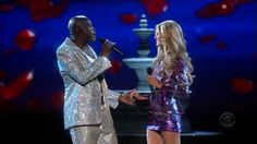 """Seal singing """"Amazing"""" and then """"Wedding Day"""" with Heidi Klum, at the 2007 Victoria's Secret Fashion Show."""