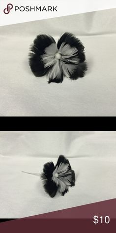 Black & White Feather Hair Flower by Alani Rose In new condition, handcrafted, Hawaiian style, black & white, feather hair flower pick. Typically worn tucked behind the ear, but you can wear it however you like. Flower sizes range from 3.5 - 5 inches across. Use it as a hair accessory or decoration in a cute vase. Alani Rose Accessories Hair Accessories