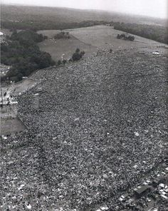 "Woodstock, 1969.  ""They went to a psychedelic pasture to listen to their music, to be with people who dressed like them and played like them. There was a shared bond on a cosmic scale, and their elders marveled that all these kids could be in one place for three days without violence or mayhem, despite pitifully inadequate facilities and food supplies, and despite rains that fell so long and hard they would have drowned any other party....."""