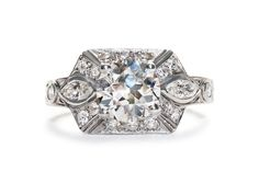 Clemson is a crisp 1930's Art Deco engagement ring featuring a 1.52ct Old European cut diamond. Highlighted by two marquise shaped diamonds, this geometric ring is definitely a unique choice!   Trumpet & Horn   $16,000