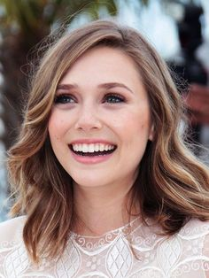 Bridal beauty inspiration: Elizabeth Olsen soft waves hairstyle, peachy complexion and makeup | allure.com