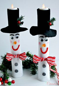 Wrapping Paper Roll Snowman Candles -- these are so darling!  I might try and play with this concept with an empty tp roll ... see what toddler craft I can come up with!  :)