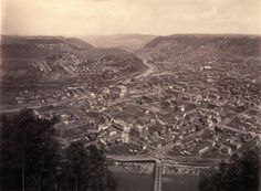 A view of Johnstown, from the top of the Inclined Plane at Westmont, by William H. In the center of the scene is Johnstown Passenger station and The Cambria Iron Works, which later became Bethlehem Steel is at the far left. Johnstown Flood, Inclined Plane, Bethlehem Steel, Pennsylvania History, Grand Canyon, City Photo, Scene, Top, Travel