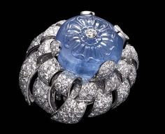 Biennale glory Cartier carved sapphire and diamond ring evoking water. well, it looks like an eyeball to meCartier carved sapphire and diamond ring evoking water. well, it looks like an eyeball to me Cartier Jewelry, Resin Jewelry, Diamond Jewelry, Antique Jewelry, Jewelry Rings, Vintage Jewelry, Jewelry Box, Diamond Rings, Cartier Rings