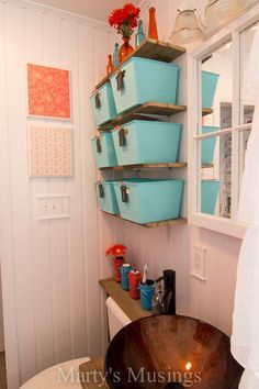 Make Your Small Bathroom Look Bigger: Install Beadboard Paneling..Our small bathroom desperately needed a makeover. Down came dated mosaic tile and old sheetrock. Installing beadboard paneling all the way to the ceiling made the small room look larger and the clean look is fabulous. Great tutorial on the blog. #diy #bathroom