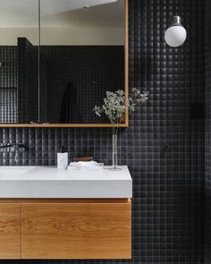 "1,137 Likes, 13 Comments - est (@est_living) on Instagram: ""INTERIORS: Sustainable timber joinery is complemented by bold matte black tiles in this bathroom in…"""