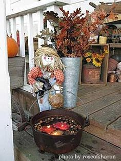 Fall porch arrangement. Love the dutch oven with floating candles, unique. This link also contains other outdoor fall decor ideas.