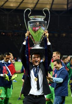 Luis Enrique manager of Barcelona celebrates victory with the trophy after the UEFA Champions League Final between Juventus and FC Barcelona at Olympiastadion on June 6, 2015 in Berlin, Germany.