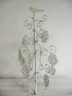 Modern Christmas tree. Crocheted ornaments.