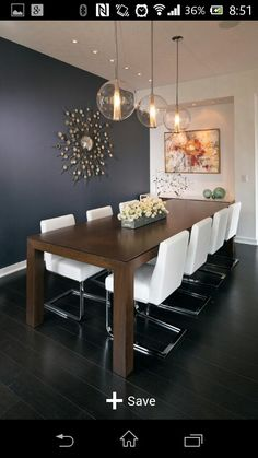 Get inspired by these dining room decor ideas! From dining room furniture ideas, dining room lighting inspirations and the best dining room decor inspirations, you'll find everything here! Modern Dining, Dining Lighting, Dining Room Design, Dining Furniture, Dining Room Paint, Modern Dining Room Lighting, Dining Room Table, Dining Room Furniture, Dining Room Centerpiece