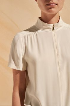 ME+EM's Zip Up Silk Top is crafted from a matte, heavyweight silk for an incredibly luxurious feel. The neckline is designed with a modern zip detail that is finished with a pale gold teardrop puller for an elegant look. Soft pleats and gathers at the sho