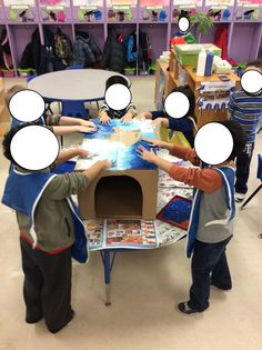 While learning about the Arctic and other cold weather places, we decided to make an igloo out of a cardboard box and blue and white paint!