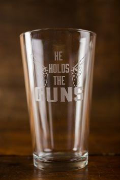He Holds the Guns and She Calls the Shots Pint Glasses