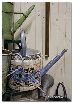 Vintage watering can with mosaic.