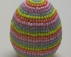 Free detailed tutorial with step by step photos on how to make a beaded Easter Egg in the square stitch bead weaving technique. Great for beginners!