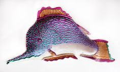 Long Snout Purple Damsel by Byron Williamson. The long snout is a delicate, gentle fish with finicky eating habits. Very difficult to lure with a worm, but well worth catching. The artist makes each of his whimsical sculptures using traditional ceramic hand-building methods: slab, coil, and pinching. After the main slab form is completed, additional sculptural pieces are attached. After the piece is fired to cone 5, a cold finish is applied using metallic paints.