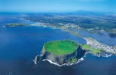 The island contains the natural World Heritage Site Jeju Volcanic Island and Lava Tubes. A central feature is Hallasan, the tallest mountain in South Korea and a dormant volcano, which rises 1,950 m above sea level. 360 satellite volcanoes are around the main volcano.