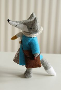 Needle felted FOX.--I'd rather he was the rusty color we usually think of foxes. Traveling with his goose I see. He's got a pretty good sized nose too.
