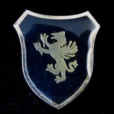 Elegant Gold Toned Black Enamel Griffin Shield Brooch – Unsigned