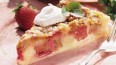 Enjoy this delicious rhubarb brunch cake sprinkled with sugar and topped with cream that's perfect for a dessert.