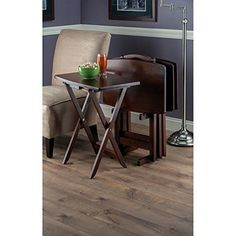 This #SnackTable Set is Great for keeping in dining room, kitchen or game room, the 5-Pc TV Table is great to have for work and play time. With Oversized tops, these wood TV Tables can easily hold a large meal with style. An upright stand stores them when not in use.  With Sturdy wooden legs.These tables are oversized to offer extra dining or working surface. Warm walnut finish.