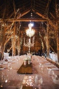 Love this ideas! String lights along branches and use wooden slabs as centerpieces! #country #brides