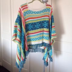Colorful Poncho Sweater Colorful whites, blues, oranges, and yellows in this unique, like-new poncho sweater. Like a Southwestern sunrise! Only worn once; like new. Mystree Sweaters Shrugs & Ponchos