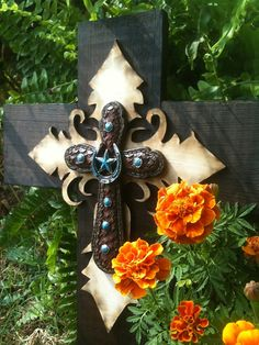 Rustic Barnwood Cross. Cut tin conduit for the embellishment and make a clay center.