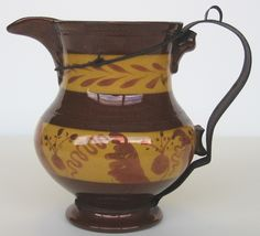Copper Lustre pitcher with tin replacement handle ca.1860