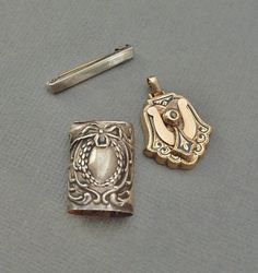 A Precious Collection of Antique Jewelry and Parts consisting of a Victorian Taille D Epergne Enamel Pendant (believe it was originally an earring), an Edwardian Hallmarked Sterling Match Safe Part with Gorgeous Double-sided Repousse, and a Tiny Sterling Art Deco Bar Pin with Engine Turned Lines circa 1890s!  Approx. Measurements: Pendant: 1 from top to bottom by 5/8. Match Safe Part: 13/16 tall by 9/16. Beauty Pin: 7/8 by 1/8. This Little Exquisite Old Miniature Col...