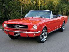 My second all-time favorite car...the 1964 1/2 Mustang Convertible. Candy Apple Red/White interior though, please.