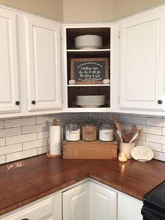 Farmhouse kitchen, butcher block, subway tile, open cabinets, kitchen counter decor, old crate, canisters, farmhouse decor.