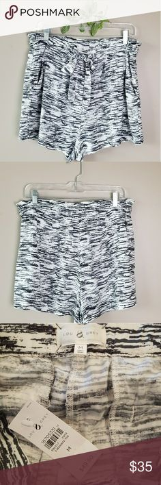 NWT. LOU & GREY High Waist/Loose/Tie Waist Shorts! NWT. These will be the most comfortable shorts you'll ever own. Loose fit style with zipper, 2 hook closure & tie waist will keep you going from day to night! 2 slanted pockets in front & 2 slit pockets in back. Dark gray/Light Black & white pattern.  Sz. M. Measurement & fabric content photos included above. Lou & Grey Shorts