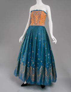 Dress by Zandra Rhodes, late 1980 - 1990 of Brilliant blue sheer silk blend plain weave printed with gold metallic, & beading - Philadelphia Museum of Art