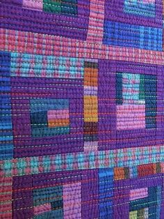 The multi color quilting thread really turns up the volume of this simple plaid quilt