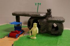 FLINTSTONE PLAYSET....MY FAVORITE TOY AS A CHILD!!!!!!  I too played with this and loved it.