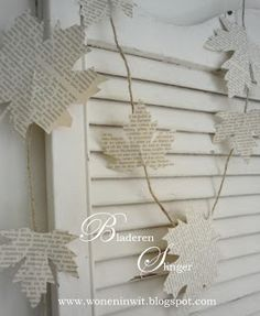 Book page leaves. - inspiration http://woneninwit.blogspot.nl/2012/10/kerst-christmas-noel-jul-items-for-sale.html