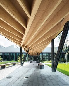 HAWE factory - Wood ceiling detail on the covered pedestrian walkway in the…