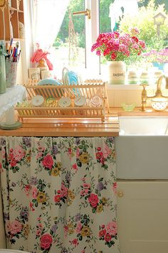The colors, the sun, the flowers, the curtain for hiding storage and the floral design on it..