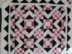 Square and star quilt pattern--There is a complete tutorial for this quilt which is 64 X 64 inches.  There is also a video tutorial as well.