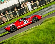 Racing car photo Ford GT40 The Goodwood Revival, red racing car, motorsport photograph. Stunning red GT40 approaching the chicane at Goodwood. Photographed in September 2015 - I hope you enjoy the sense of speed conveyed by this photograph. This print is 18x12 inches and printed on Ilford Smooth Gloss 310 gsm paper. I can supply smaller, matted prints - message me for a bespoke order to be created.