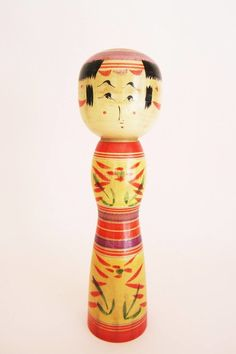 Yajiro kokeshi doll, vintage, with bright colors and her very special design of the eyes. See more pics on folkeshi.com