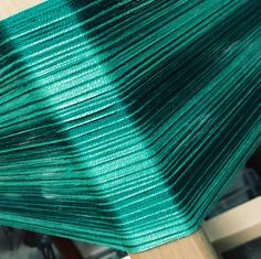 "The greens in this new shawl kit are so rich. This is the warp-wouldn't it make an elegant shawl?  Warp and weft are wound for you.  Just add a 20"" loom and weave!  It's as simple as it sounds"