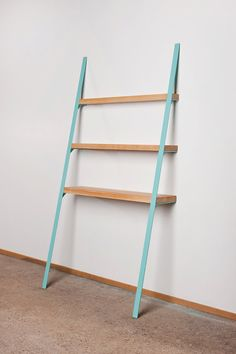 This cool, powder-coated steel and wood shelf leans right against the wall. #etsy