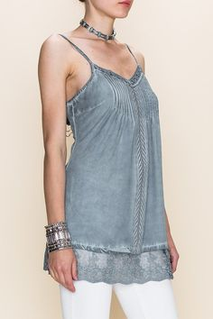Oil washed camisole top with lace hemline and adjustable straps. - 100% Rayon