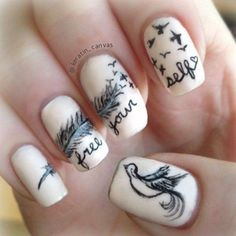 The more creativity you add on your nails the more interesting it looks. Black and white feather nail art that travels through the nails. Add a bird detail on one of the nails for better accent.