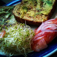 Savoury French toast with avocado, sliced tomato, alfalfa & Spanish onion.