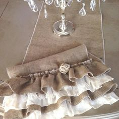 I did a custom order for a Customer who wanted one on our Burlap and Cream Ruffled Table Runners, with a little added flair. We added a Lace Ruffle Topper on the Cream Ruffles and a Linen Fabric Flower to each end. I loved the way it turned out, so we are adding this upscaled design